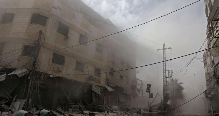 Smoke and dust are seen following a reported regime air strike in the rebel-held town of Hamouria, in the besieged Eastern Ghouta region, on February 21. (AFP)