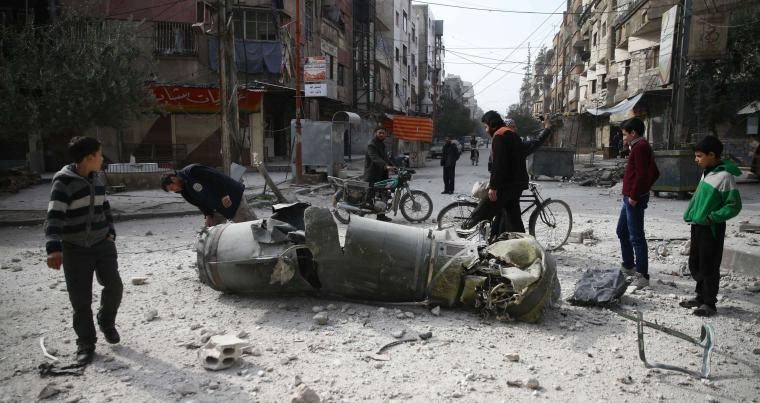 Systematic destruction. People inspect missile remains in the besieged Syria town of Douma, in eastern Ghouta, in Damascus, on February 23. (Reuters)