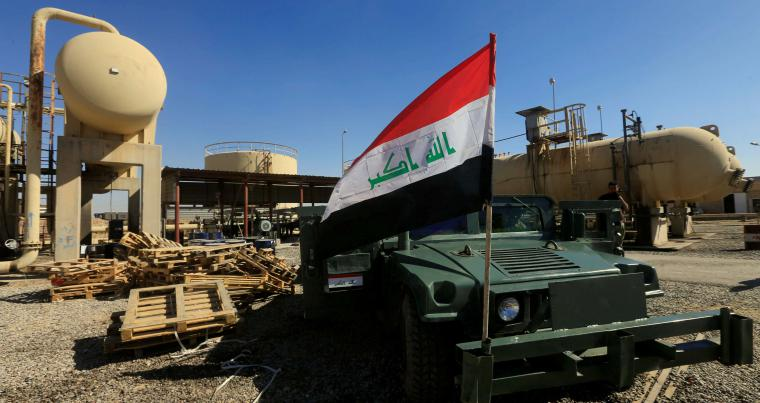 An Iraqi flag mounted on a military vehicle at an oil field in Dibis area on the outskirts of Kirkuk. (Reuters)