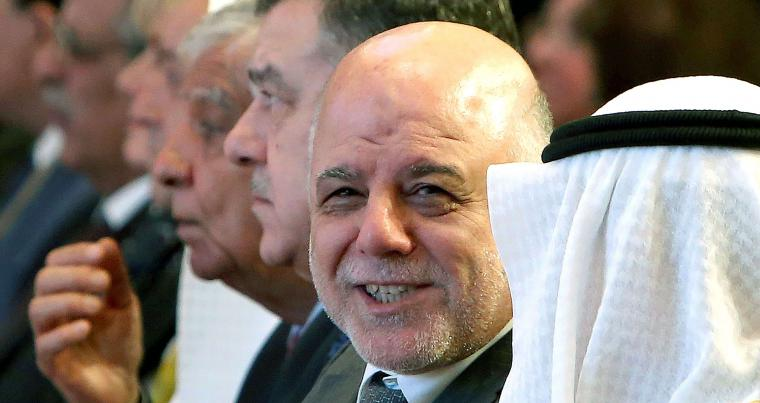 Iraqi Prime Minister Haider al-Abadi (C) attends the Kuwait international conference for the reconstruction of Iraq in Kuwait City, on February 13. (AFP)