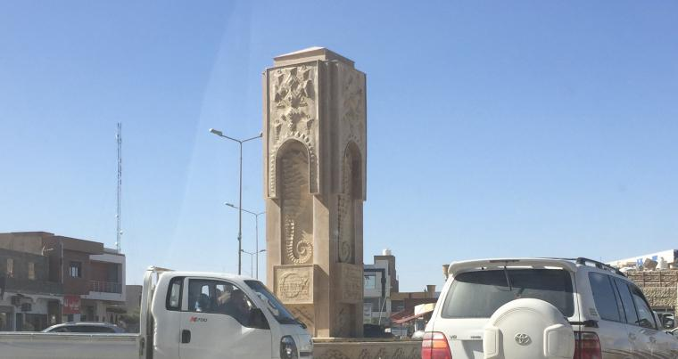 A monument with Arabic and Amazigh inscriptions in the middle of a roundabout in the centre of Zuwara.  (Michel Cousins)