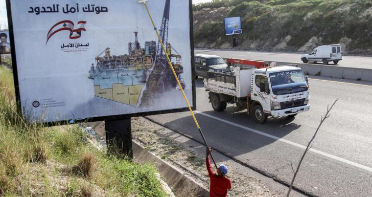 "Electoral billboards for the upcoming 2018 May parliamentary elections in Lebanon by the largely Shia Amal movement with a tagline reading in Arabic ""Your vote is a hope (Amal) for the borders."" (AFP)"