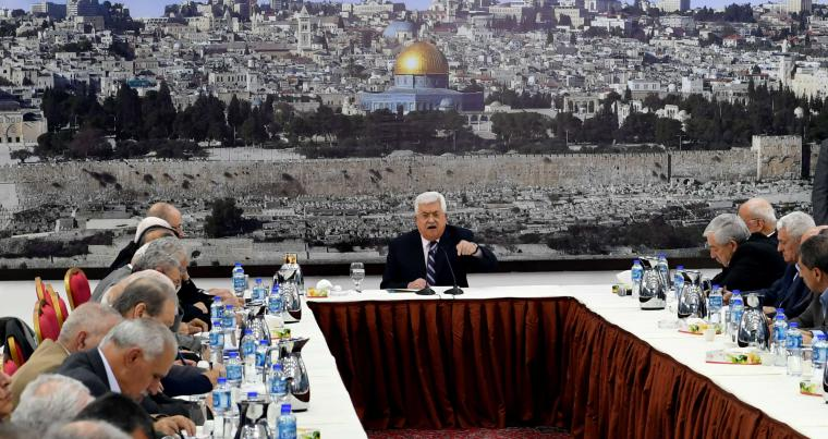 Palestinian President Mahmoud Abbas (C) speaks during a meeting with the Palestinian leadership in Ramallah, on March 19. (Reuters)