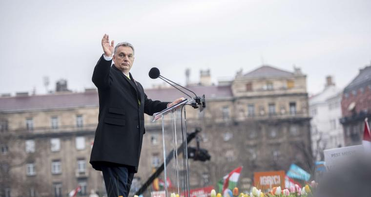 Hungarian Prime Minister Viktor Orban arrives on the stage to address the crowd celebrating the national holiday in Budapest, on March 15. (AP)