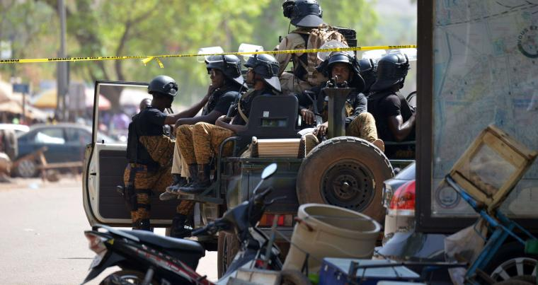 Burkinabe soldiers patrol in Ouagadougou, a day after dozens of people were killed in twin attacks on the French embassy, on March 3. (AFP)