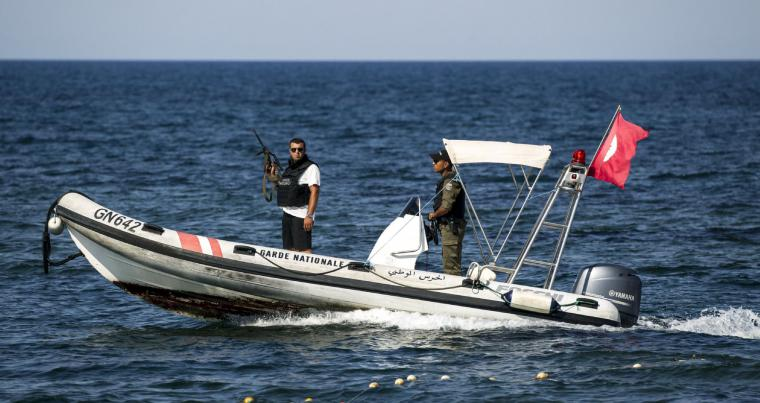 Members of Tunisia's National Guard patrol in a boat off the coast of Sousse. (Reuters)