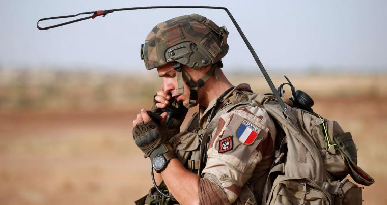 A French soldier checks the IMEI number of a mobile phone during a regional anti-insurgent operation in Inaloglog in Mali, last October. (Reuters)