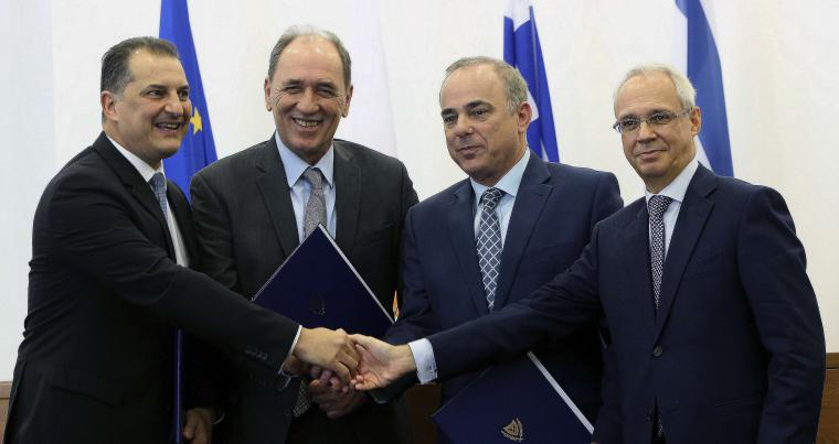 Italian ambassador in Cyprus Andrea Cvallari (R), Israel's Energy minister Yuval Steinitz (2nd R), Greece's Energy minister Giorgos Stathakis (2nd L) and Cyprus' energy minister Yiorgos Lakkotrypis (L) shake hands after their talks in Nicosia, last December. (AP)