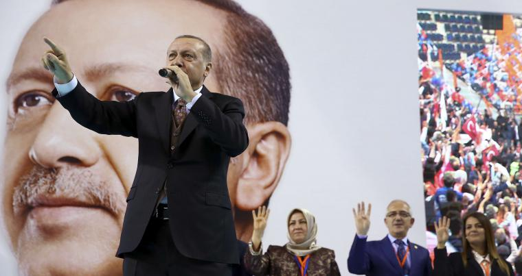 Turkish President Recep Tayyip Erdogan gestures as he delivers a speech during a rally of his ruling Justice and Development Party's supporters in Mersin, on March. (AP)