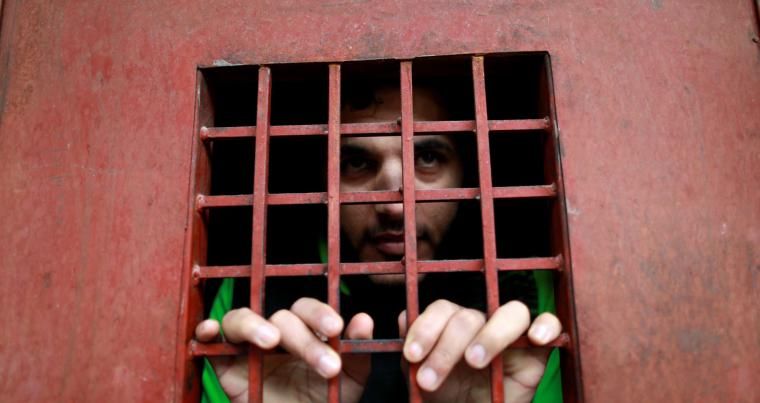 An Islamic State member looks out from a cell in the Iraqi city of Sulaymaniyah, last year.      (Reuters)