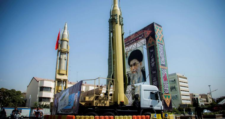 A display featuring missiles and a portrait of Iran's Supreme Leader Ayatollah Ali Khamenei is seen at Baharestan Square in Tehran, in September. (Reuters)