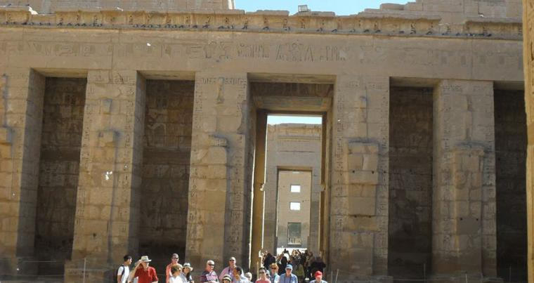 Tourists stand in front of the Madinat Habu temple in Luxor in southern Egypt.(Ahmed Megahid)