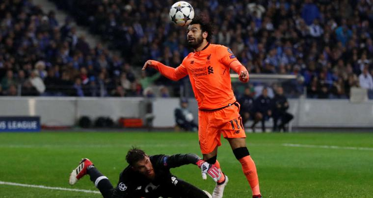 Liverpool's Mohamed Salah (R) goes past FC  Porto's Jose Sa before scoring the team's second goal, on February 14.(Reuters)