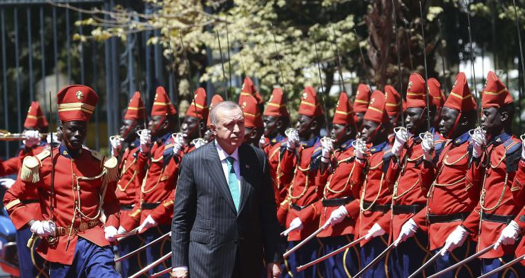 Turkish President Recep Tayyip Erdogan reviews a Senegalese honour guard during ceremonies in Dakar, on March 1.  (AP)