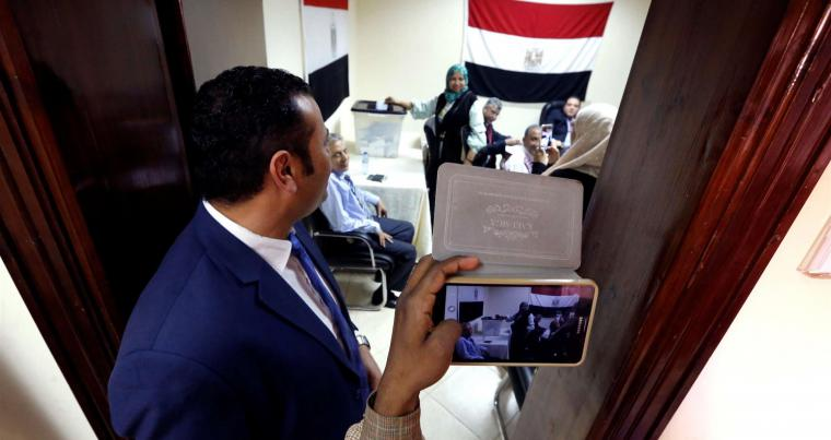 Egyptians living in Sudan cast their vote at the Egypt Embassy in Khartoum, on March 16. (Reuters)