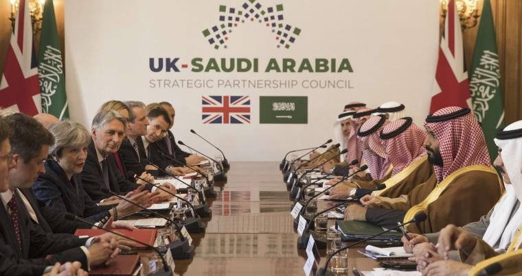 Saudi Crown Prince Mohammed bin Salman bin Abdulaziz (2nd R) conducts a meeting with Britain's Prime Minister Theresa May (2nd L) and other members of their delegations inside 10 Downing Street in London, on March 7.  (AP)