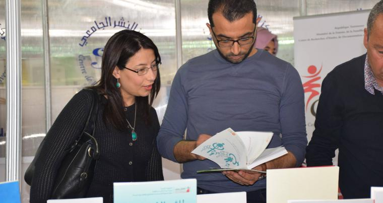Visitors browse books at the CREDIF stall at the Tunis International Book Fair. (CREDIF)