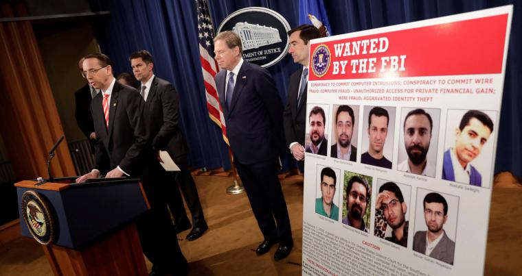 US Deputy Attorney General Rod Rosenstein speaks during a press conference at the Justice Department to announce nine Iranians charged with conducting massive cyber theft campaign, on March 23. (Reuters)