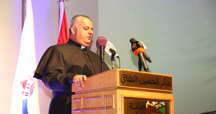 CCSM Director Father Rif'at Bader speaks at the first Islamic-Christian celebration of the Feast of the Annunciation in Amman.                                             (Souran Khodanian)