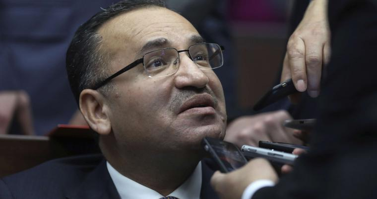 Turkish Deputy Prime Minister Bekir Bozdag speaks to the media in Ankara, last February. (AP)