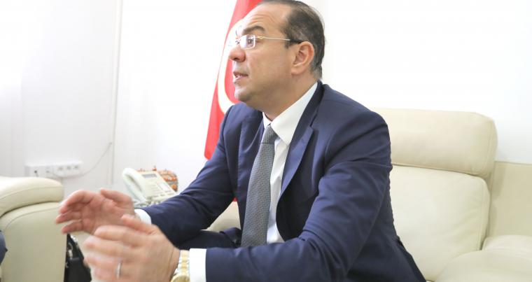 Mehdi Ben Gharbia, the Tunisian minister in charge of the government's relations with Constitutional institutions, Civic society and Human Rights, speaks to The Arab Weekly at his office in Tunis, on April 5.                                                     (The Arab Weekly)