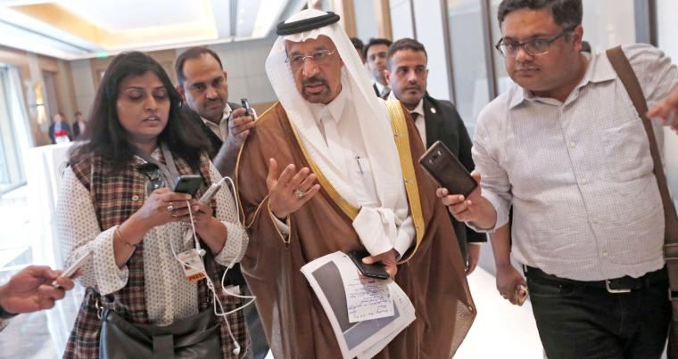 Expanding market share. Saudi Energy Minister Khalid al-Falih (C) speaks to the media as he leaves after a meeting in New Delhi, last February.            					                (Reuters)