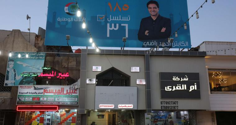 The campaign poster of Ahmed Radhi, a former Iraqi footballer, hanging in a street in Baghdad, on April 23. (AFP)