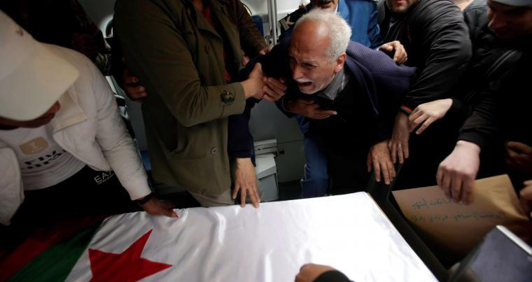 The father of a victim of an Algerian military plane crash mourns during his son's funeral in Algiers, on April 12. (Reuters)