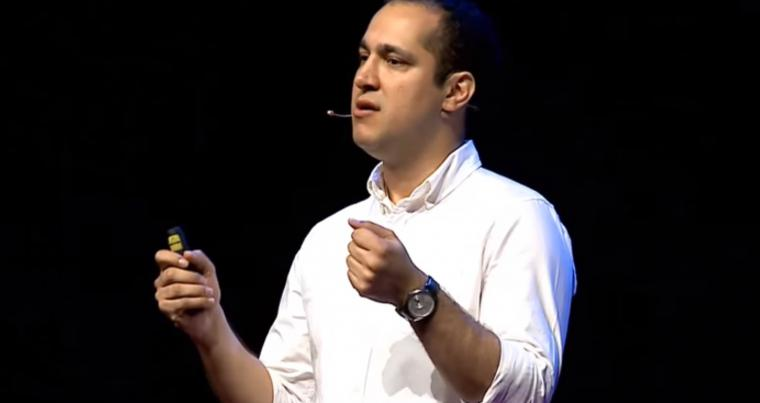 An image grab of Iranian environmentalist Kaveh Madani during a public talk. (YouTube)