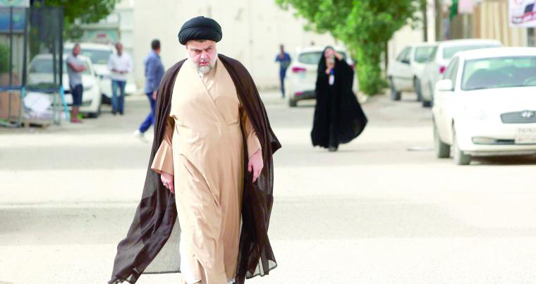 Kingmaker? Iraqi Shia cleric Muqtada al-Sadr heads to a polling station during the parliamentary election in Najaf, on May 12. (Reuters)