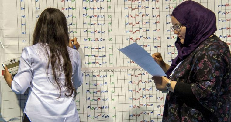 Election officials count the results of the municipal vote at a sorting centre in Tunis, on May 7. (AP)