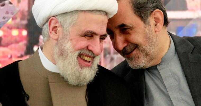 For better or worse. Ali Akbar Velayati (L), top adviser to Iran's Supreme Leader Ali Khamenei, talks with Lebanon's Hezbollah Deputy Leader Naim Qassem during a conference in Beirut. (Reuters)