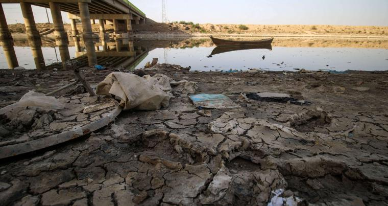 Water-starved land. A view of the dried-up shore of an irrigation canal near the village of Sayyed Dakhil, south of Baghdad. (AFP)
