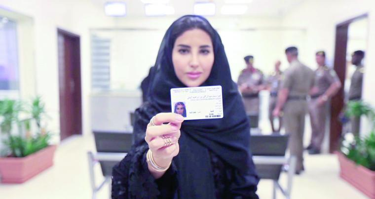 A Saudi woman displays her brand new driver's licence at the General Department of Traffic in Riyadh, on June 4. (Saudi Information Ministry)