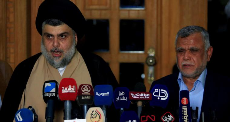 Iraqi Shia cleric Muqtada al-Sadr (L) speaks during a news conference with the leader of the Conquest Coalition and the Iran-backed Shia militia Badr Organisation Hadi al-Amiri in Najaf, on June 12.  (Reuters)