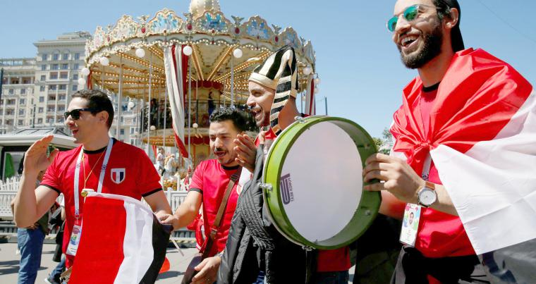 Supporters of the Egyptian national football team cheer during a gathering in central Moscow, on June 15. (Reuters)