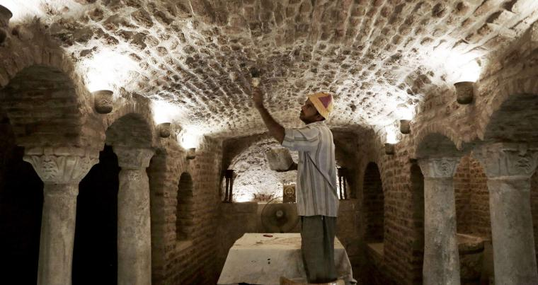 A file picture shows a worker renovating part of the Cavern Church in Old Cairo, Egypt. (AP)