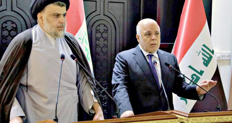 Iraqi Prime Minister Haider al-Abadi (R) and Shia cleric Muqtada al-Sadr speak at a news conference in the heavily fortified Green Zone in Baghdad, on May 20.  (Iraqi Government)