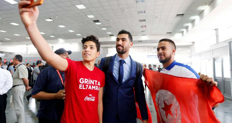 In great spirits. Tunisian fans take a selfie with defender Yassine Meriah before the departure of the national football team from the Carthage International Airport, on June 7.                                                                                                                                                                           (Reuters)
