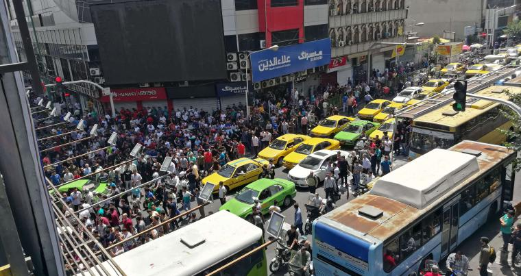 Iranian protesters gather at Mobile market in Tehran on June 25. (AFP)