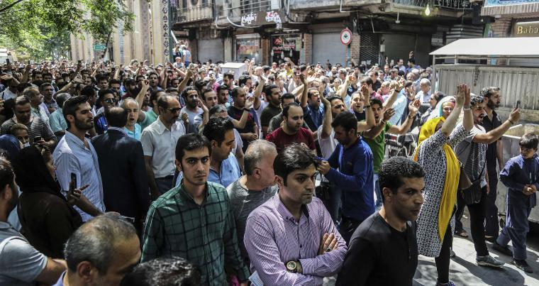 A group of protesters chant slogans at the old grand bazaar in Tehran, on June. (Iranian Labor News Agency via AP)