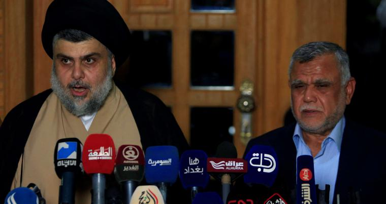 Iraqi Shia cleric Moqtada al-Sadr speaks during a news conference with Iran-backed Shia militia leader Hadi al-Amiri, in the city of Najaf, on June 12. (Reuters)