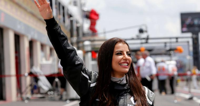 Aseel Al-Hamad of Saudia Arabia drives a Lotus Renault E20 Formula One car during a parade before the race, in France's Le Castellet, on June 24. (Reuters).
