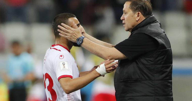 Tunisia's Ferjani Sassi (L) celebrates his penalty goal with Tunisia coach Nabil Maaloul during a match between Tunisia and England at the 2018 soccer World Cup in Volgograd, Russia, on June 18, 2018. (AP)