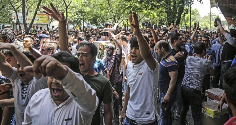 A group of protesters chant slogans at the old grand bazaar in Tehran, Iran, Monday, June 25, 2018 (Iranian Labor News Agency via AP)