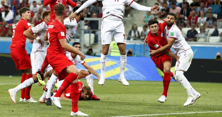 Tunisia's Dylan Bronn (11) goes for a header during the group G match against England at the 2018 soccer World Cup. (AP)