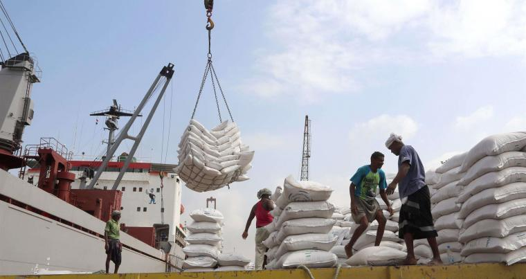Easing the suffering. File picture shows workers unloading wheat from a cargo ship in the Red Sea port of Hodeidah. (AFP)