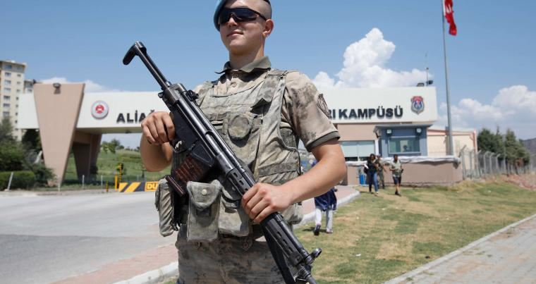 A Turkish soldier stands guard in front of the Aliaga Prison and Courthouse complex in Izmir, on July 18. (Reuters)