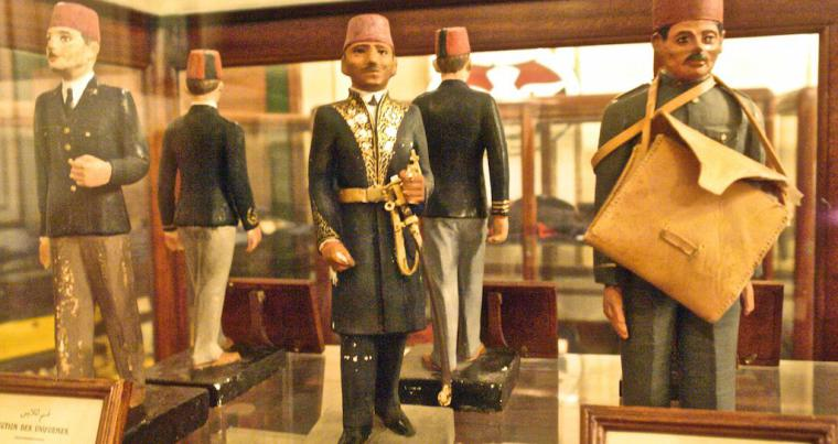 Miniature statues of postal workers on display at the Postal Museum in Cairo. (Postal Museum)