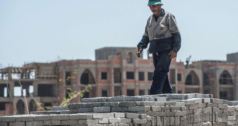 Ambitious plans. An Egyptian labourer walks at construction site.  (AFP)